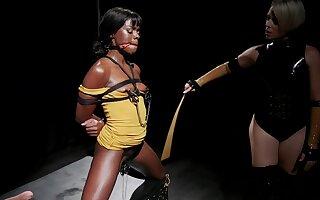 Latex mistress Helena Locke abuses ebony Ana Foxxx with a strap on