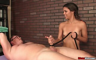 Naked guy enjoys getting his dick massageg by a charming chick