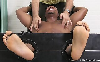 Tied up black guy enjoys while a dirty old dude tikles his body