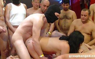 Black haired slut with red lipstick cum sprayed in a threesome