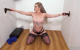Blonde slut Kay Carter drops on her knees to please 2 black dicks