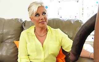 Mature lady Payton Hall spreads her legs for a massive black dick