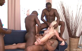 First gang bang for the skinny blonde and a serious bath of jizz